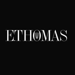 E. Thomas